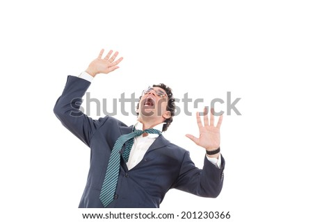 frightened  and shocked business man looking up, fear of something, high prices on market, high or low shares in the stock market - stock photo