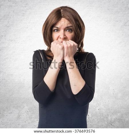 Frightened brunette woman - stock photo