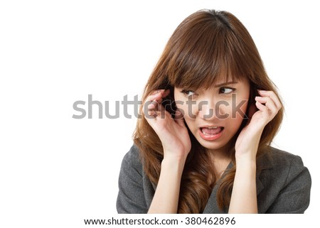 frightened business woman looking - stock photo