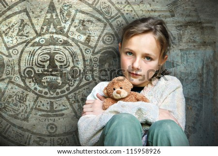 Frightened child with mayan calendar on her background. - stock photo