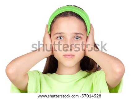 Frightened girl with ears plugged isolated on a white background - stock photo