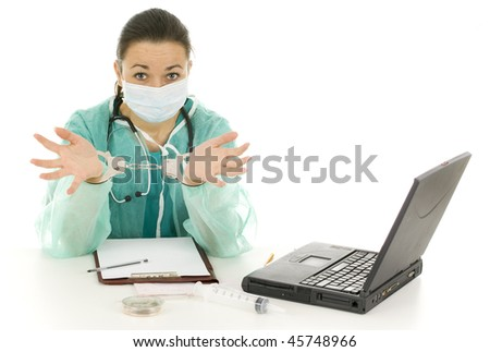 frightened  lady doctor in green uniform and medical mask with handcuffed hands at office - stock photo