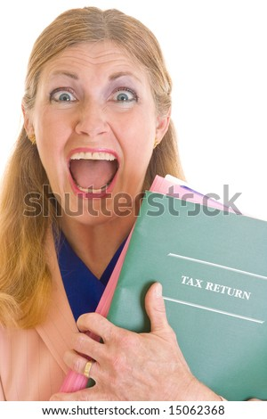 Frightened, scared middle aged woman screaming because she needs to complete her I.R.S. taxes by the April 15th deadline. - stock photo