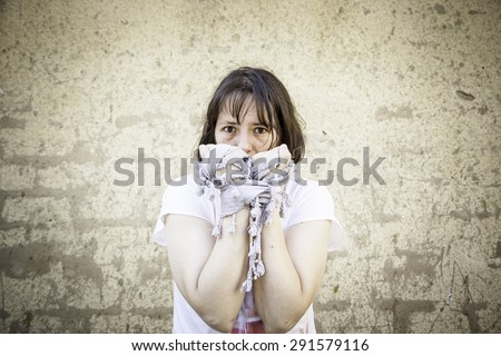 Frightened woman in fear and hands tied - stock photo