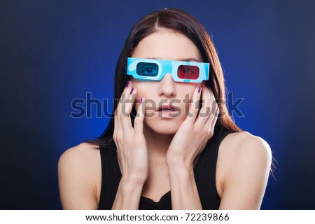 Frightened woman in stereo glasses - stock photo