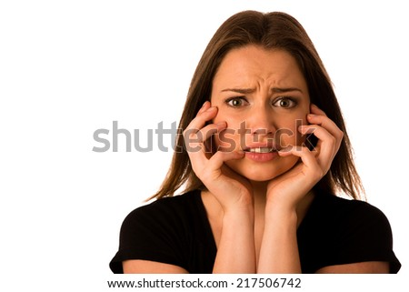 Frightened woman - preety girl gesturing fear isolated - stock photo
