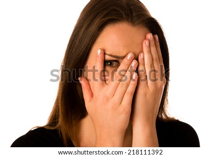 Frightened woman - pretty girl gesturing fear isolated - stock photo