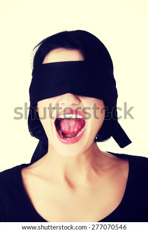 Frightened woman with black band on eyes.