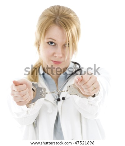 frightened  young female doctor with handcuffed hands - stock photo
