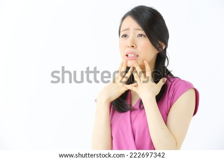 frightened young woman isolated on white background - stock photo