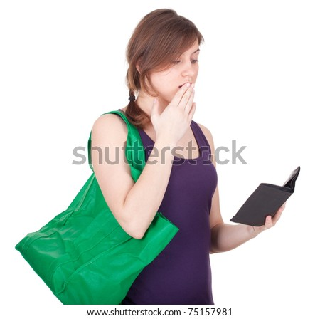 frightened young woman with green ecological shopping bag - stock photo