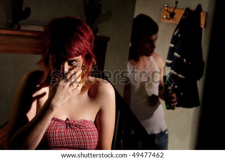 Frightened young woman with menacing alcoholic man - stock photo