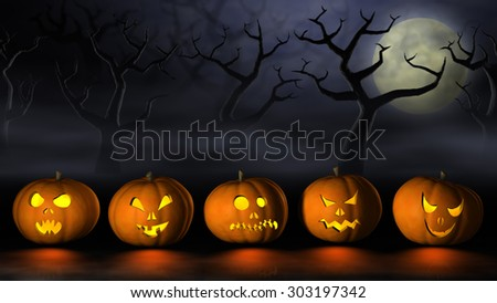 Frightening Halloween pumpkins or Jack O'Lanterns in a spooky and misty forest under a full moon at night. - stock photo
