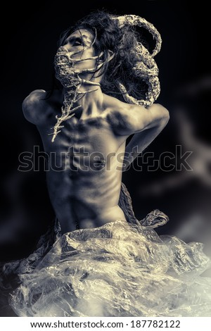 Frightening mythical creature male. Alien creature. Horror. Halloween. - stock photo