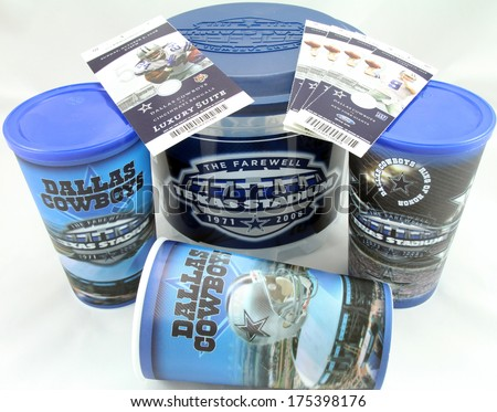 FRISCO, TX - FEB 6, 2014: Close-up of Dallas Cowboys football hologram drink cups, popcorn bucket and tickets from the last season in Texas Stadium. Stadium was imploded on 4/11/2010. - stock photo