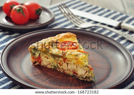 Frittata with Fresh Vegetables and chicken meat on plate - stock photo