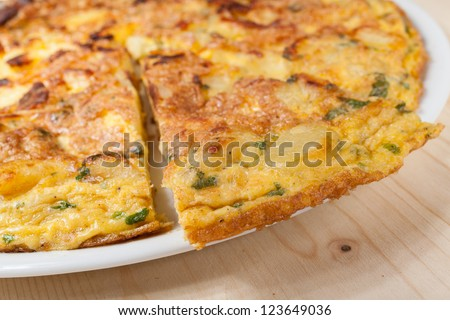 Frittata with potatoes, Parmesan and parsley - stock photo