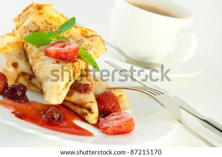 Fritters with strawberry jam and mint and a cup of coffee