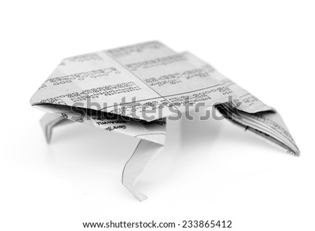 Frog origami from newspaper isolated on white background - stock photo