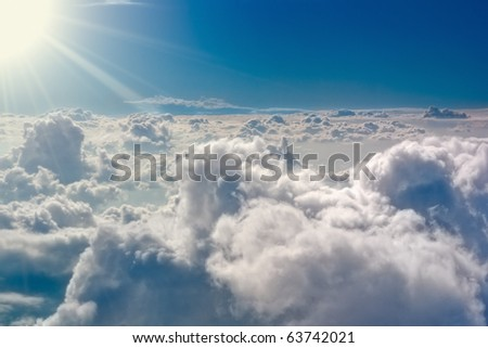 From above it is not so terrible. The stormy clouds shined from above with the sun. View from airplane. - stock photo