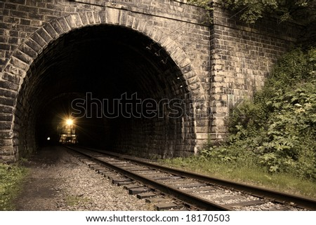 From dark to light. Old railroad tunnel of the Circum-Baikal Road. - stock photo