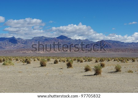 From mountains to desert to high mountains near Death Valley, California - stock photo