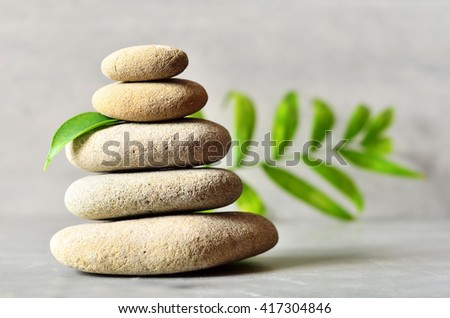 From spa stones make Balances pyramids and leaf. Spa concept. - stock photo