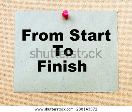 From Start To Finish written on paper note pinned with red thumbtack on wooden board. Business conceptual Image - stock photo
