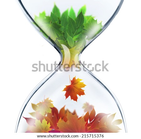 From summer to autumn.The changing seasons concept with hourglass - stock photo
