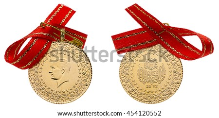 Front and back sides of whole Turkish gold coins with ribbon isolated on white background.