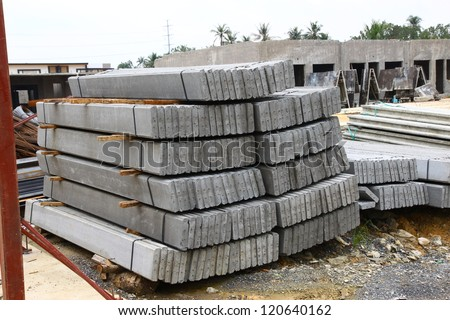 Front and side view of concrete pole pile on ground - stock photo