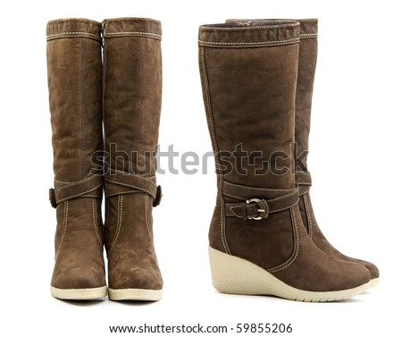 Front and side view of pair of brown female winter boots on white background - stock photo