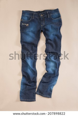 Front Blue jeans trouser on the beige background