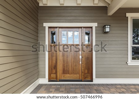 Front brown door with a window