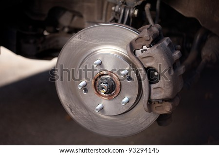 Front Disk brake assembly on a modern car - Brake job in progress - stock photo