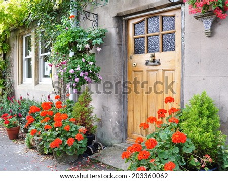 Front Door of a Beautiful Old English Cottage - stock photo