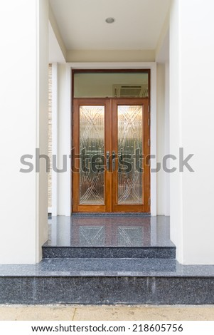 Front door of exclusive expensive house decorate with wood and granite floor