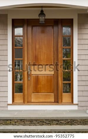 Front door showing hanging light fixture - stock photo