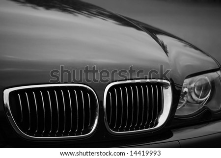 Front end of a luxury vehicle - stock photo