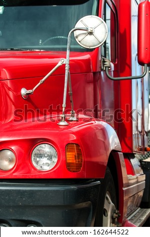 Front end of a semi truck while parked - stock photo
