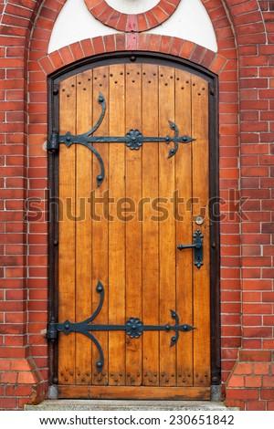 Front entrance door of Evangelism Lutherans Christies in Germany - stock photo