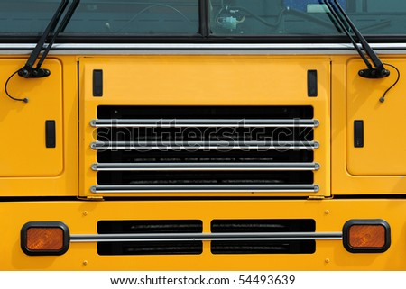 Front grill of a school bus - stock photo
