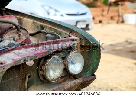 Front headlight of an old car. - stock photo