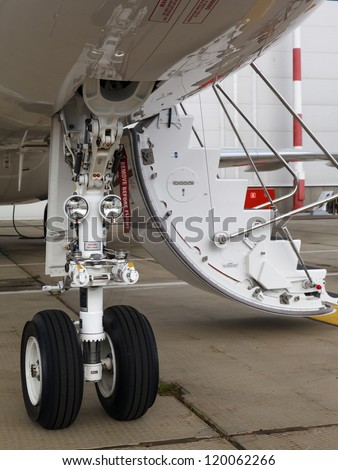 front landing gear and ladder light aircraft on the ground - stock photo