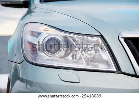 Front light of a modern car closeup - stock photo
