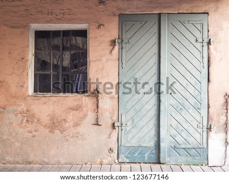 Front of a abandoned house with window and door - stock photo