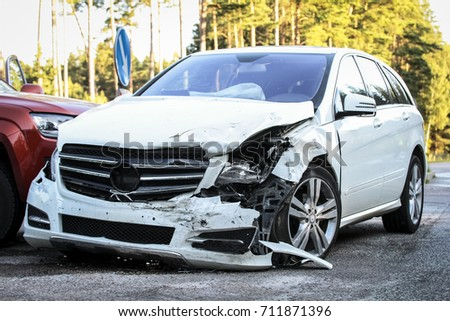 Front of a car get damaged by crash accident on the road