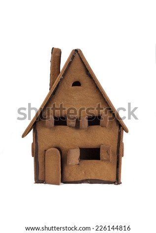 Front of a gingerbread house ready for decorating on white background - stock photo