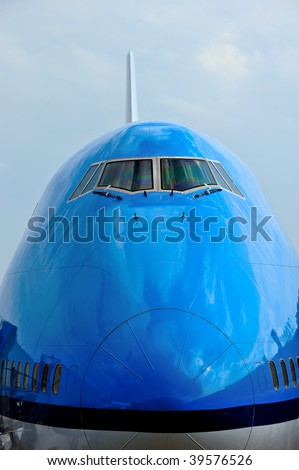 Front of a large passenger airliner - stock photo