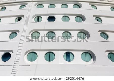 Front of a Luxury cruise ship with portholes - stock photo